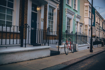 old bike front of an vintage brown house in a famous  street of london