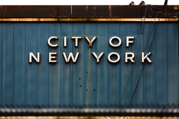 inscription city of new york on metal wall