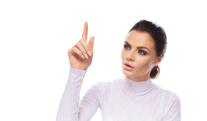 Beauty portrait of a young beautiful brunette model pointing index finger up isolated on white background with copyspace