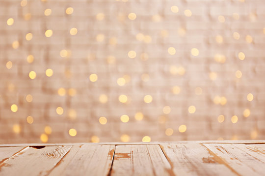 Selective focus. Soft yellow christmas lights with bokeh effect. Festive blurry texture background with many lit mini lamps, new year holiday decorations. Close up, copy space.