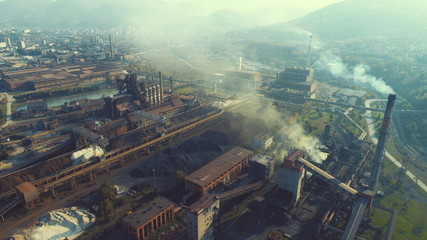 Aerial top view of metallurgical industry factory abstract background top view pollution concept