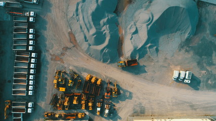 Aerial top view of crushed stone quarry machine in a construction material factory - fototapety na wymiar