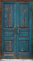 Old aged painted worn blue and brown isolated door