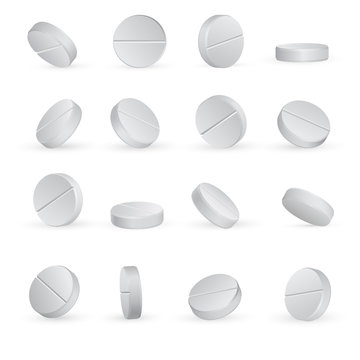 Round white medical pills in different positions.