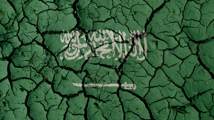 Political Crisis Or Environmental Concept: Mud Cracks With Saudi Arabia Flag