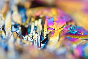 Beautiful colorful background of thin layer of titanium on the surface of quartz. Macro