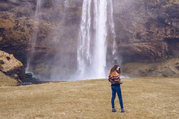 Woman in casual wear near waterfall