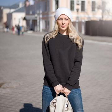 Street fashion look. Beautiful girl in black hoody