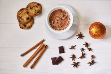 Beautiful composition with cup of cappuccino and Christmas cookies on the white wooden table