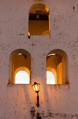 Street light and old colonial Chinchero church, Peru