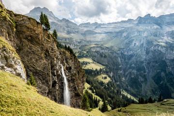 waterfall in the swiss alps, hiking in the kiental valley, switzerland