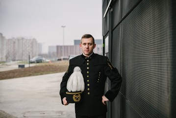 Man black coal miner in gala parade uniform