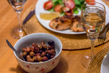 Cooked olives with olive oil, white wine and fish dish