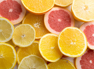 Texture of sliced lemon, orange and red grapefruit