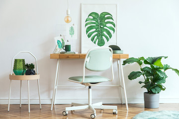 Stylish scandinavian interior with mock up poster frame and a lot of plants. Brown wooden parquet and white backgrounds wall. Floral concept art.