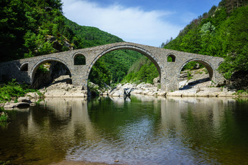 Devil's Bridge in Ardino Bulgaria top on Arda River, It is Ottoman Architecture Bridge in Rodopi Mountains