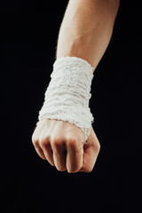 wrist wrapped with healing bandage