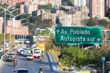 Cityscape and traffic sign road to Poblado, Medellin