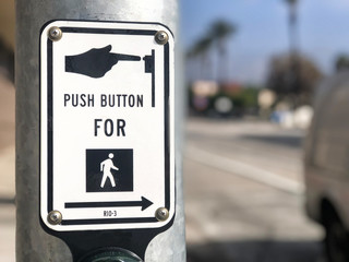 Push button for crossing sign