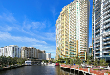 Fort Lauderdale's Riverfront, bustling with boating activity and lined with high rise condos and apartments located at Las Olas Boulevard in downtown Fort Lauderdale, Florida.