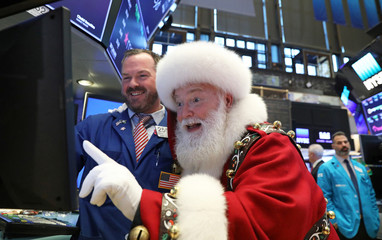 Santa Claus pays a visit on the floor at the New York Stock Exchange (NYSE) in New York