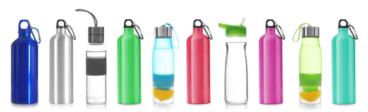 Set with different sport bottles on white background