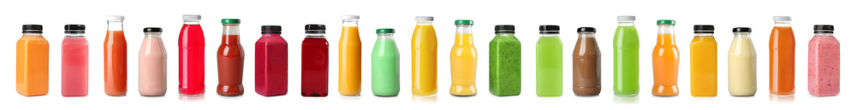 Set with bottles of different juices on white background