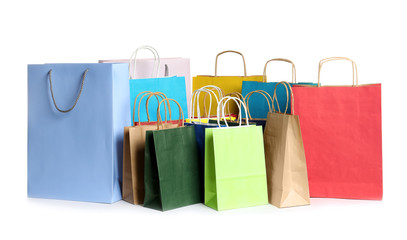 Colorful paper shopping bags on white background