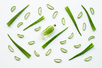 Extract with leaves and slices of aloe vera on white background.