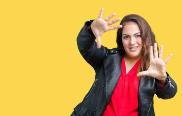 Beautiful plus size young woman wearing a fashion leather jacket over isolated background Smiling doing frame using hands palms and fingers, camera perspective