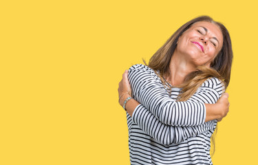 Wall Mural - Beautiful middle age woman wearing stripes sweater over isolated background Hugging oneself happy and positive, smiling confident. Self love and self care