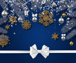 Christmas and New Year background with fir branches, snowflakes and satin bow.
