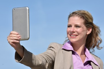Adult Blonde Business Woman Smiling With Tablet