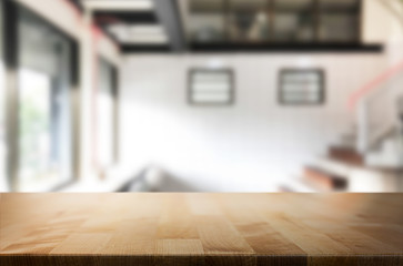 Wooden board empty Table Top And Blur Interior over blur in coffee shop Background, Mock up for display of product