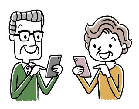 シニア女性とシニア男性:スマートフォン