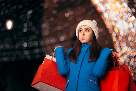 Tired Girl Holding Shopping Bags on Christmas Lights Décor