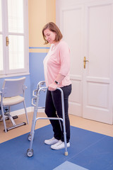 A Woman using recovery equipment after surgery
