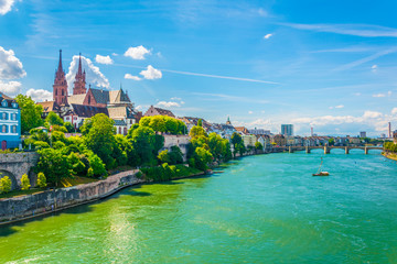 Riverside of Rhine in Basel dominated by majestic building of Munster church, Switzerland Fototapete