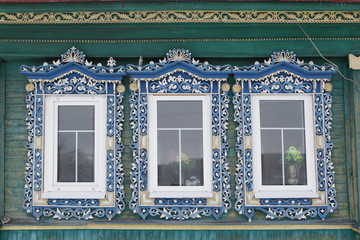 Сarved windows on wooden rural house in Russia