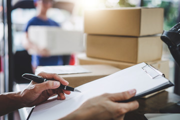 Home delivery service and working service mind, Woman working checking order to confirm before sending customer in post office