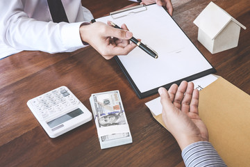 Business Signing a Contract Buy - sell house, Man sign a home insurance policy on home loans, insurance agent analyzing about home investment loan Real Estate concept
