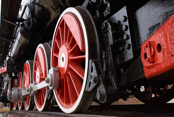 red and white wheels of the old classic steam locomotive, close up view