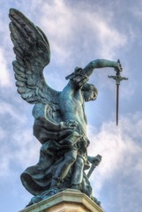 Bronze statue of Michael the Archangel, standing on top of St. Angelo's castle