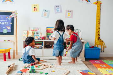 Young children enjoying in the playroom