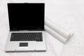 Laptop with architectural plans