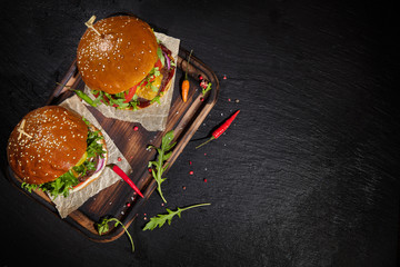Delicious hamburgers, served on stone.