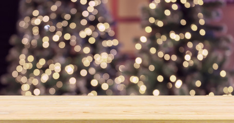 Empty wood table top with Abstract blur Christmas tree with decoration bokeh light background for product display