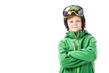 Preteen boy in ski clothes with arms crossed smiling and looking at camera isolated on white