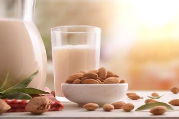 Alternative milk of almonds in rustic kitchen close up
