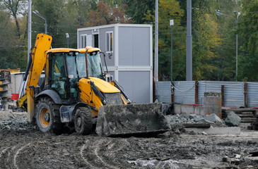 Dirty tractor or excavator removes dirt